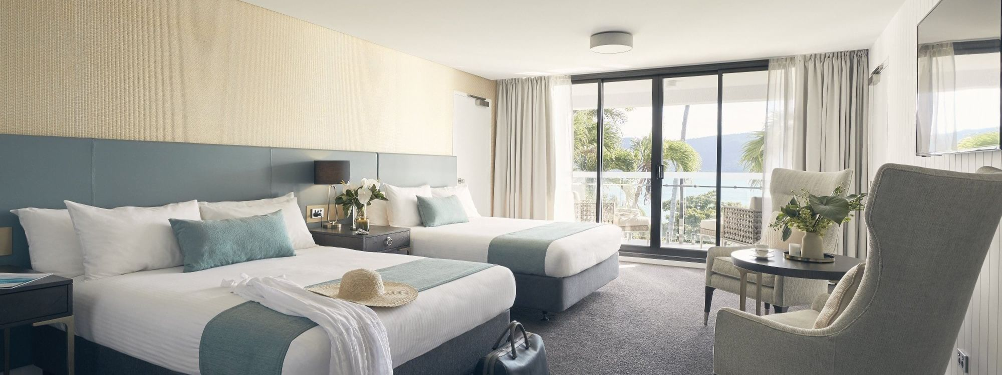 Two beds in Deluxe Serenity Twin room at Daydream Island Resort