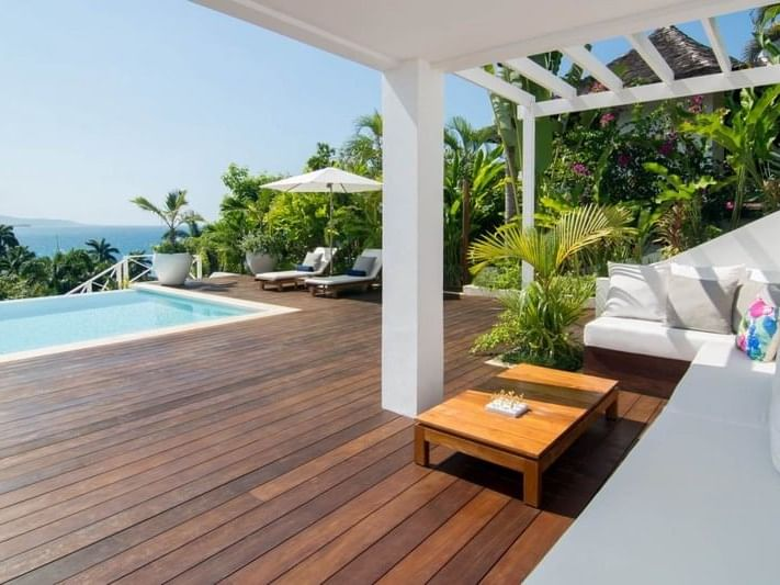 Pool area and the outdoor seating area at Spotlight Villa 11 in Round Hill Hotel & Villas