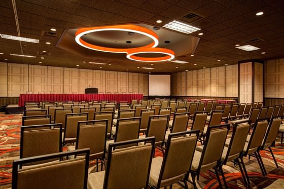 rows of chairs facing a projector screen