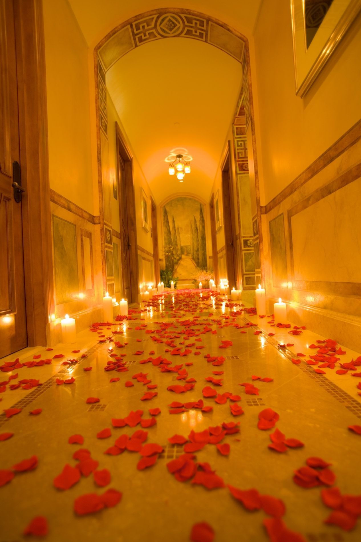 hallway with candles and rose petals on the ground
