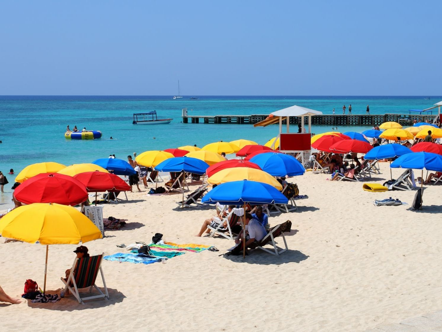 Jamaica Public Beach with people by the beach under colorful umbrellas
