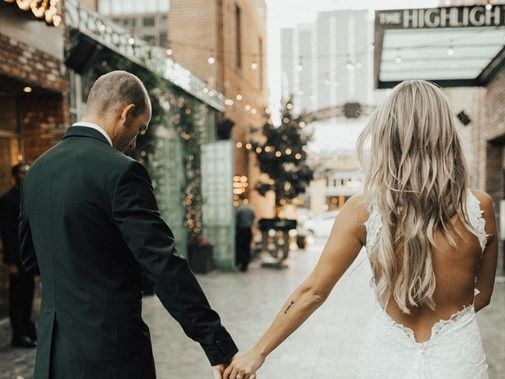 Newlywed couple walking on a sidewalk near Dream Hollywood LA