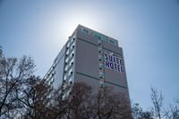 Campus Tower Suite Hotel - Exterior with Signage