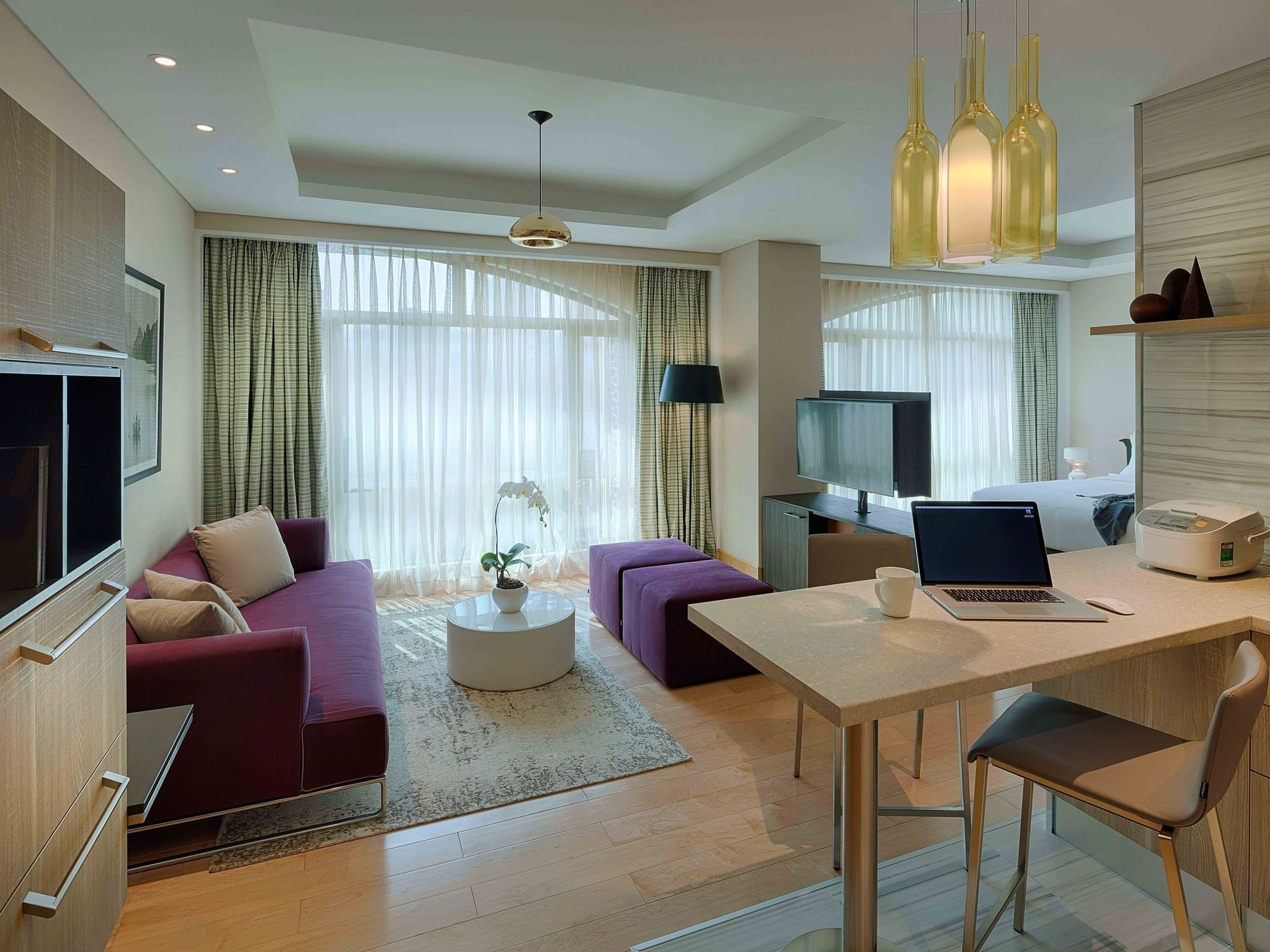 spacious living area with sofa, dining area, and coffee table