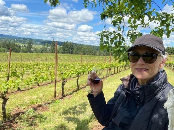 Guest enjoying wine in the vineyard
