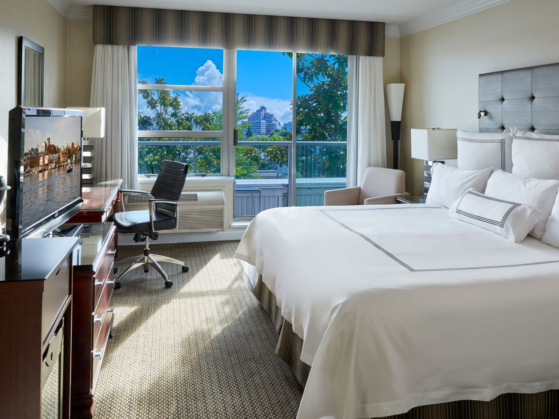 The Premium Balcony King bedroom at Granville Island Hotel