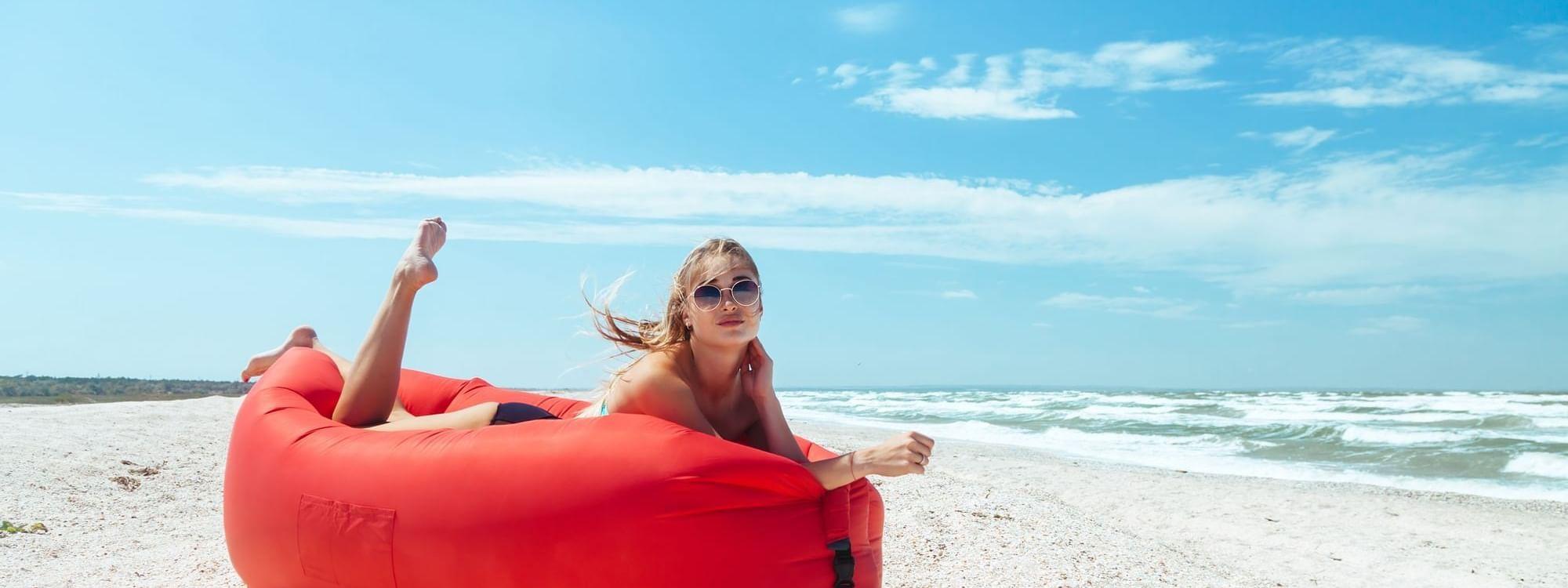 Woman sun bathing on beach at Daydream Island Resort