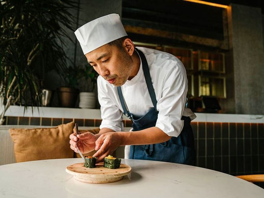 chef putting rolls together