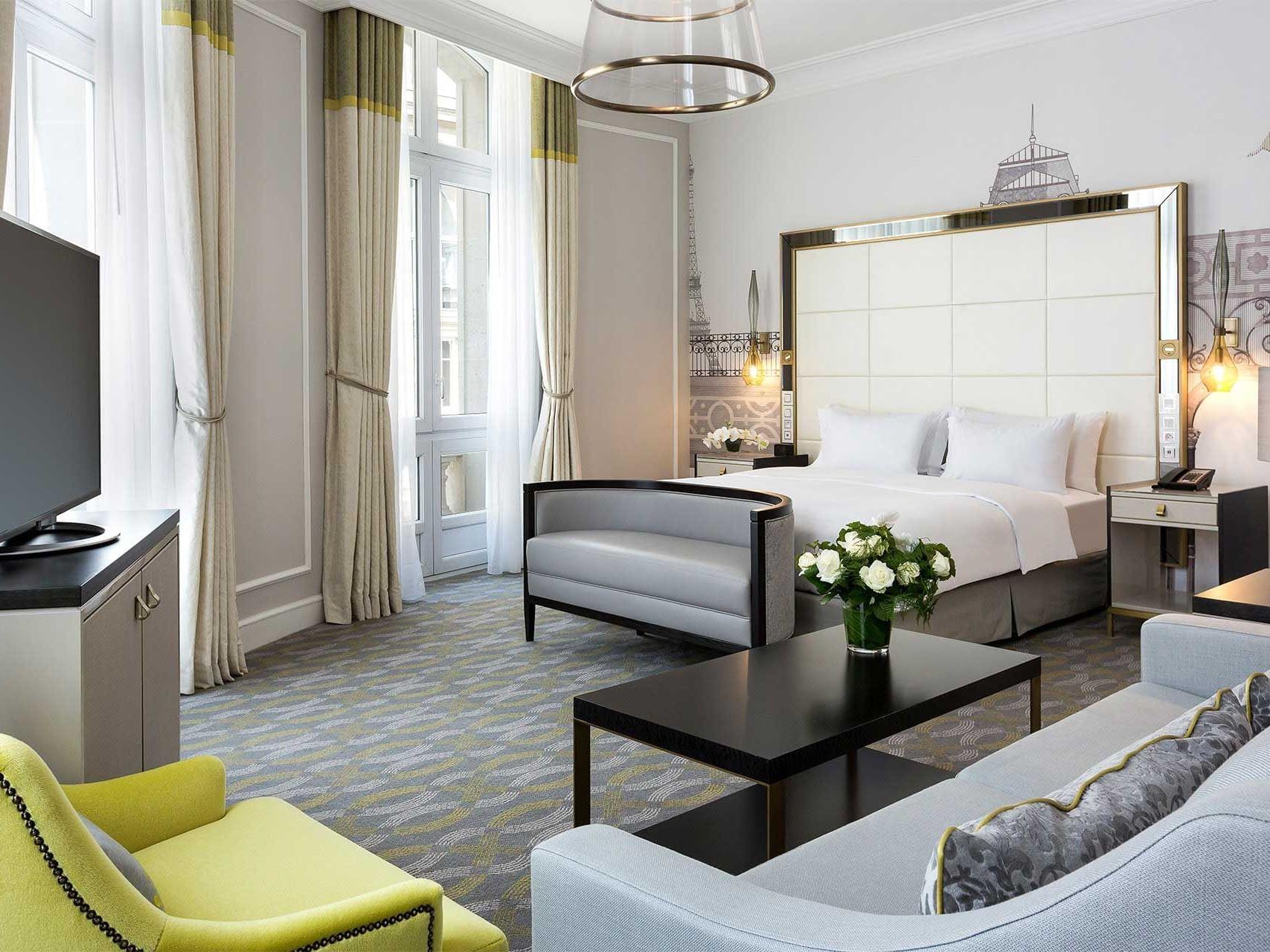 King Junior Suite Bed & furniture at Hilton Paris Opera Hotel