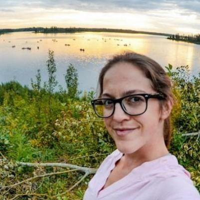 Selfie of a Lady beside a lake near Varscona Hotel on Whyte