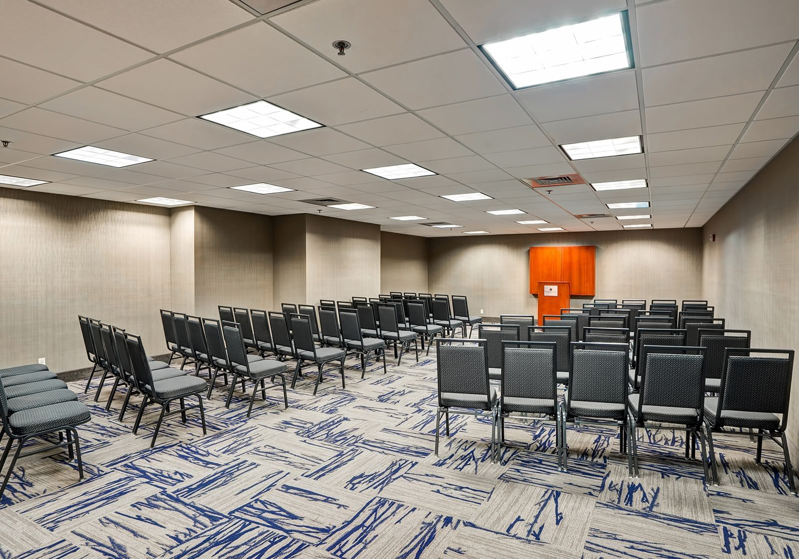 rows of chairs facing a podium