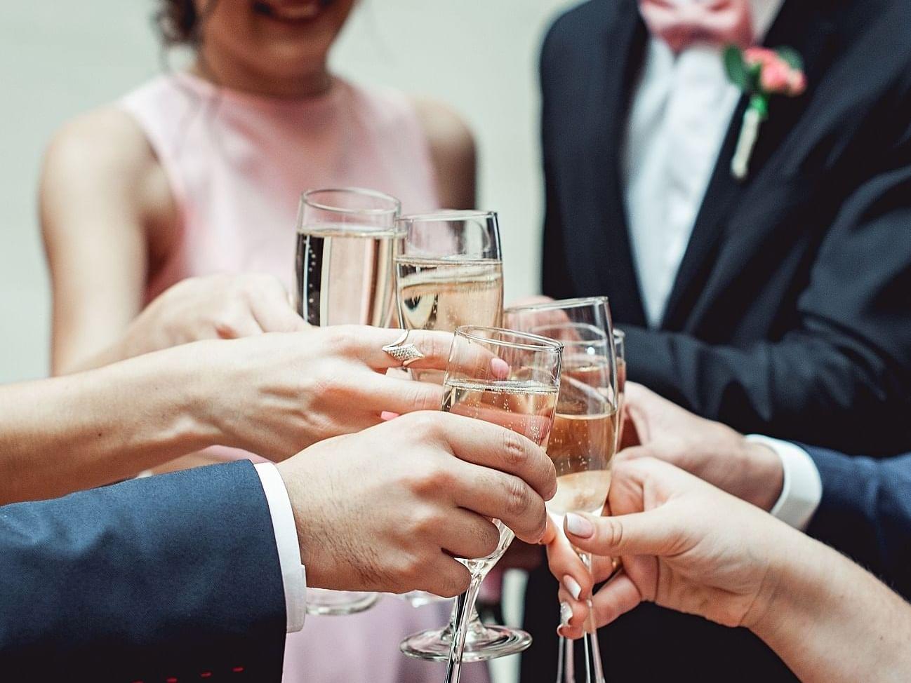 Guests Clinking champagne glasses at  Artyzen Grand Lapa Hotel Macau