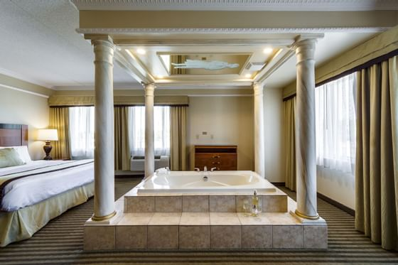King Bedroom at Monte Carlo Inn Barrie Suites