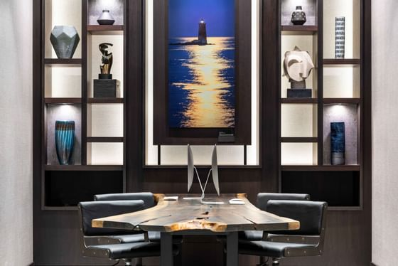 modern table with artwork on shelf