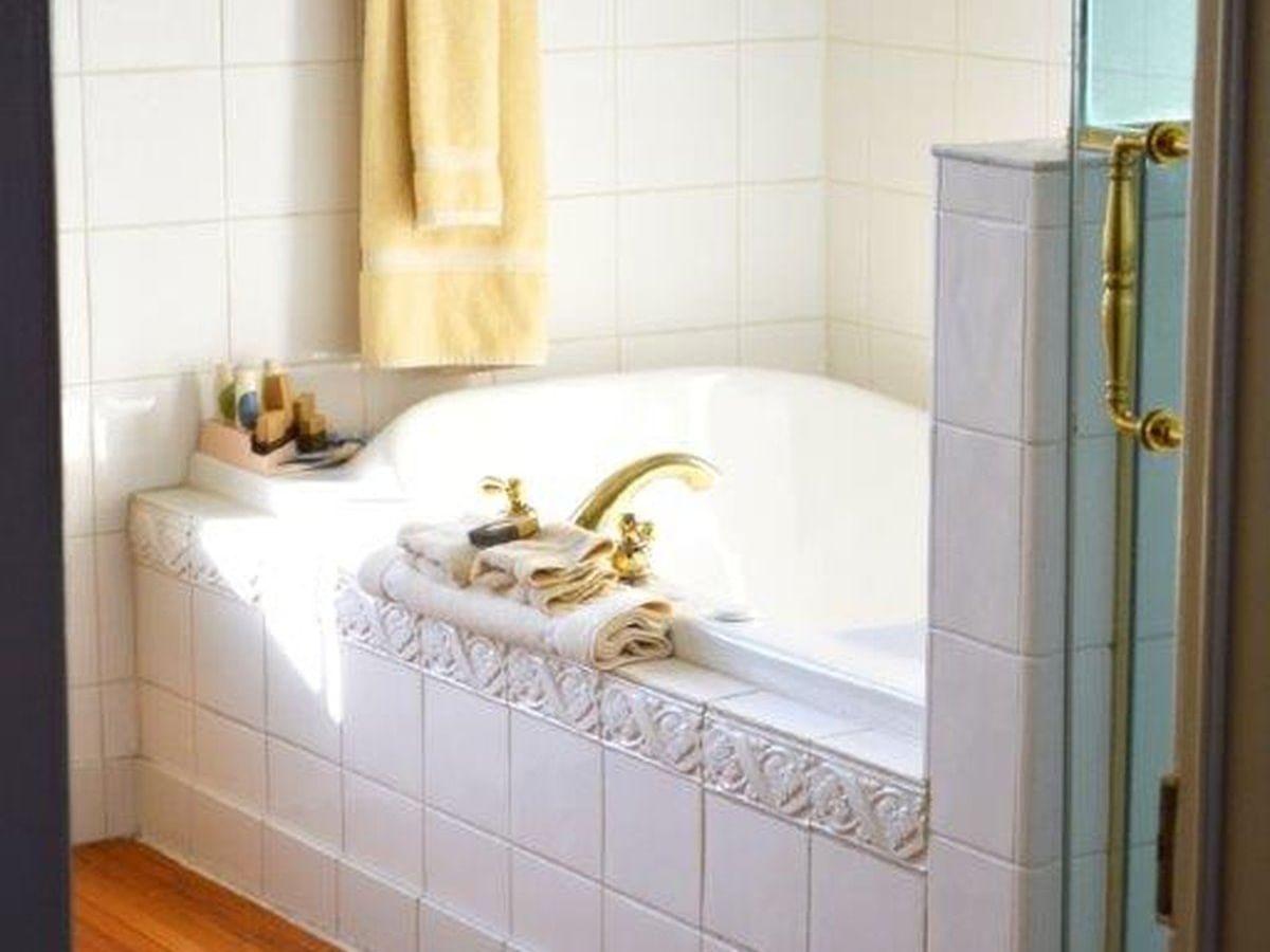 tiled bathroom with bathtub