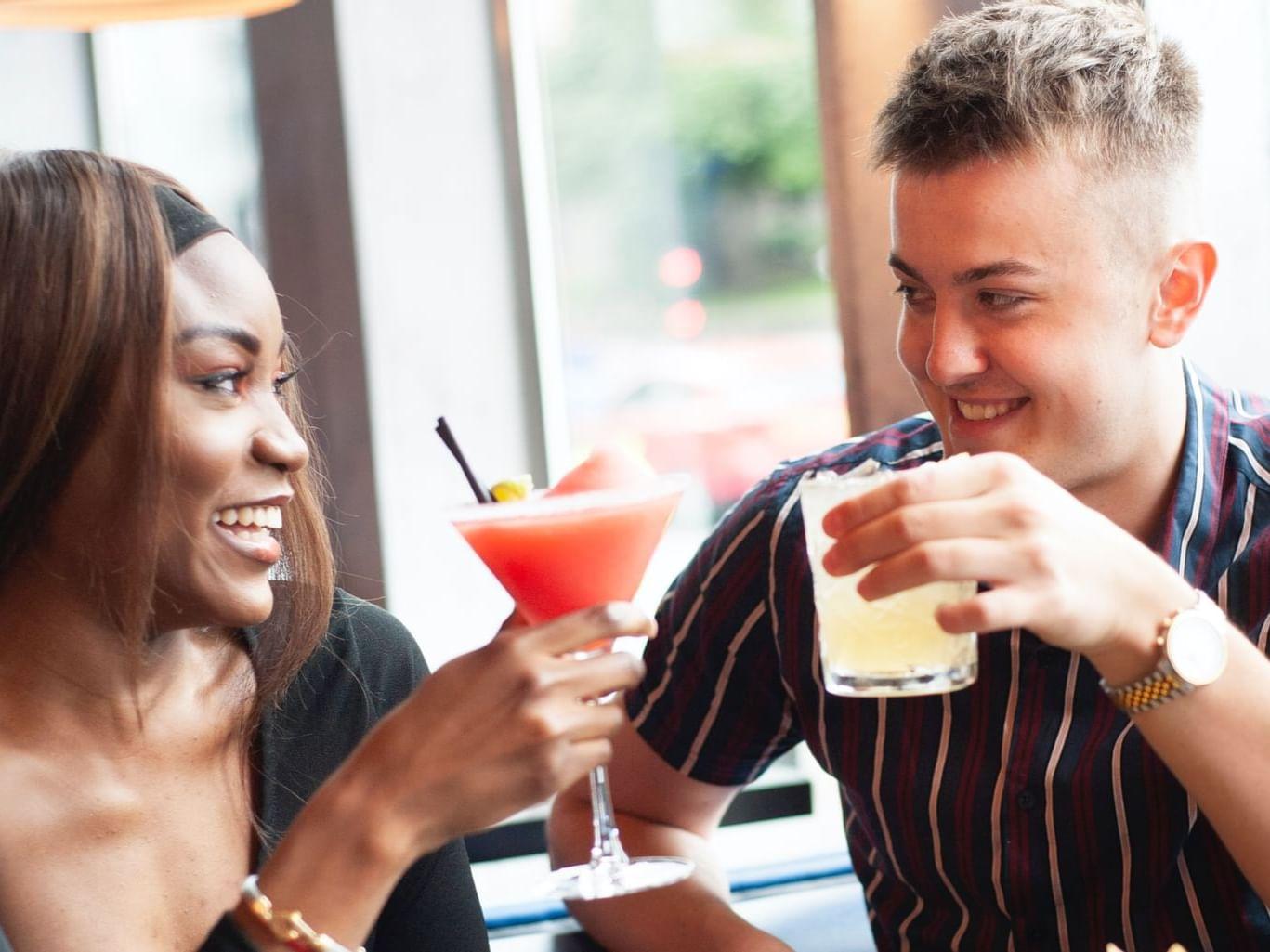 A couple having a fresh juice