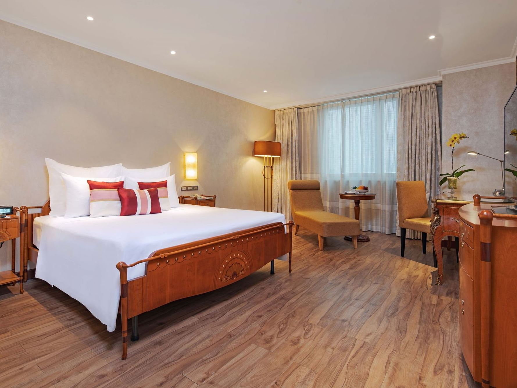 spacious hotel room with wood furniture