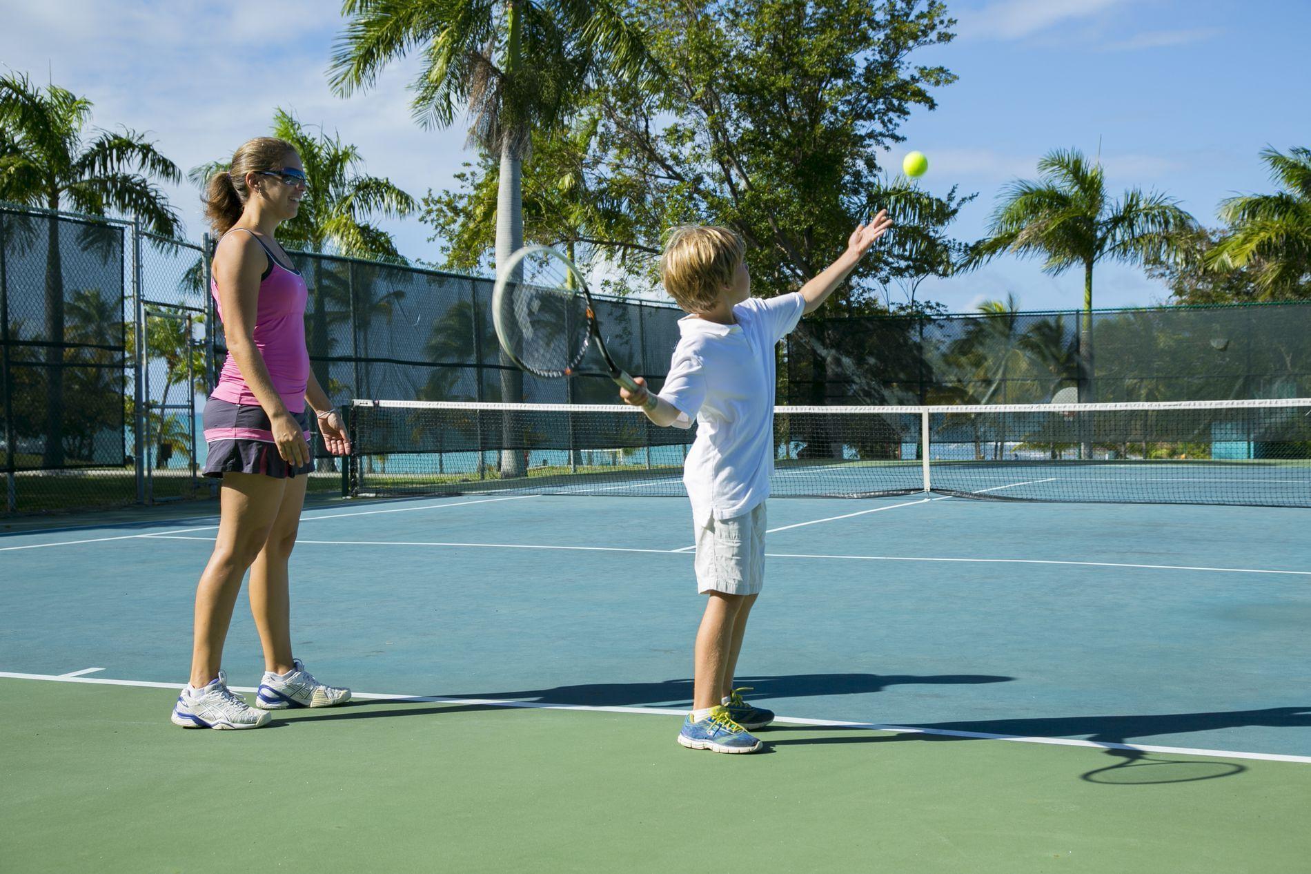 Mom & son playing tennis