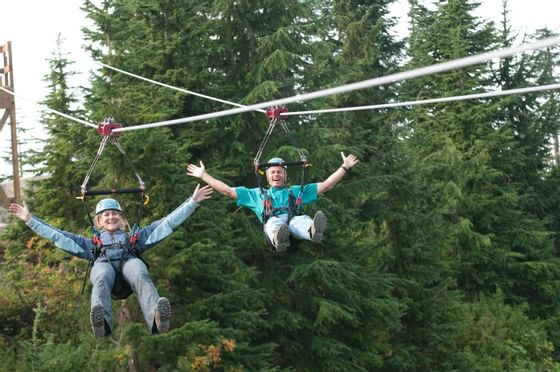 Couple zip lines in grouse mountain near Granville Island Hotel
