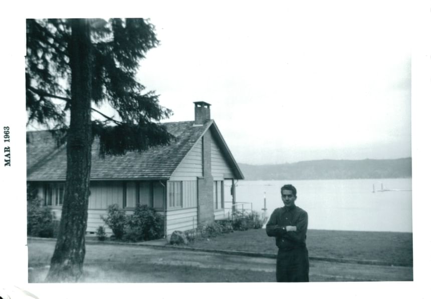 An old picture of a man standing outside the Alderbrook Resort