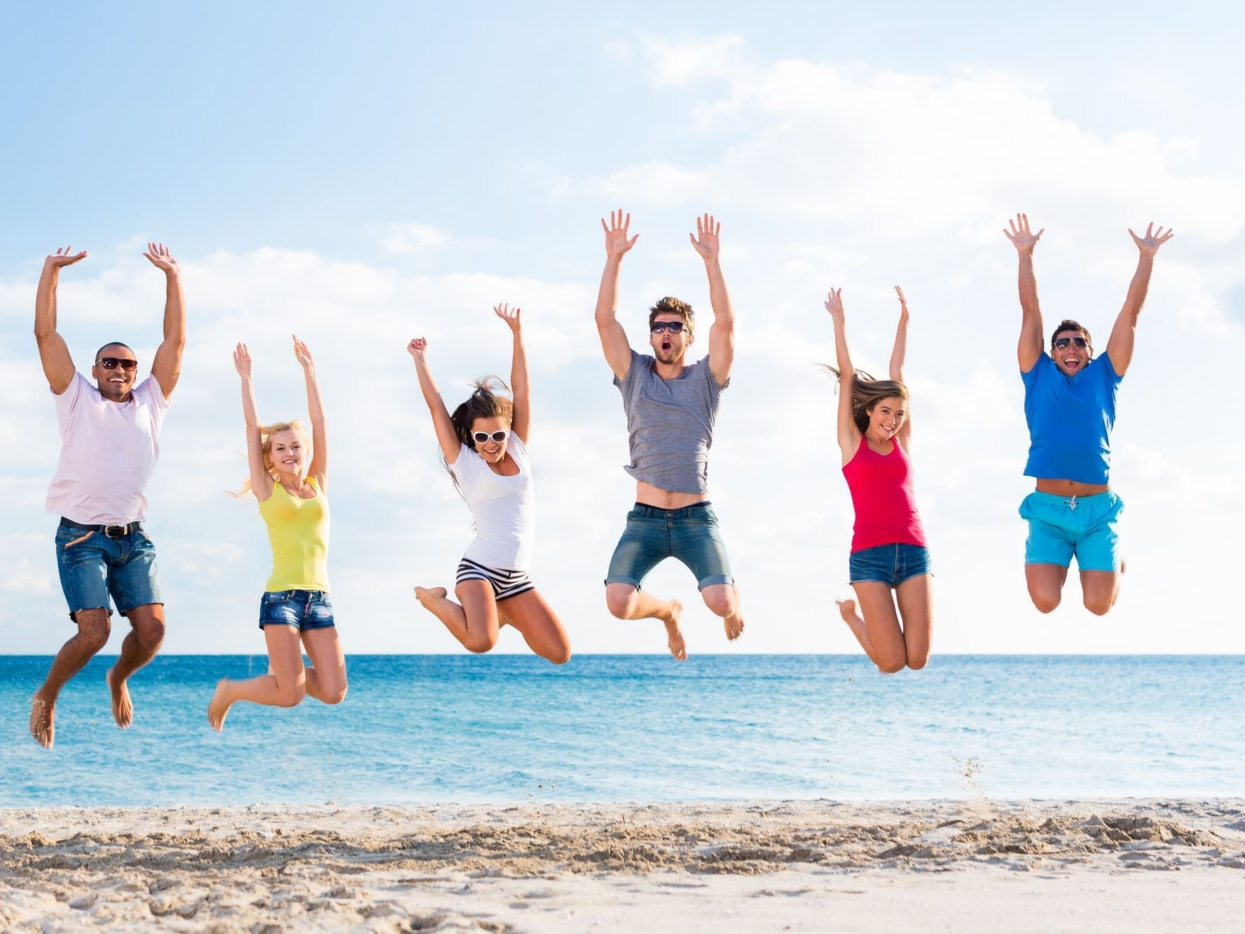 Group of friends having fun on beach at Daydream Island Resort