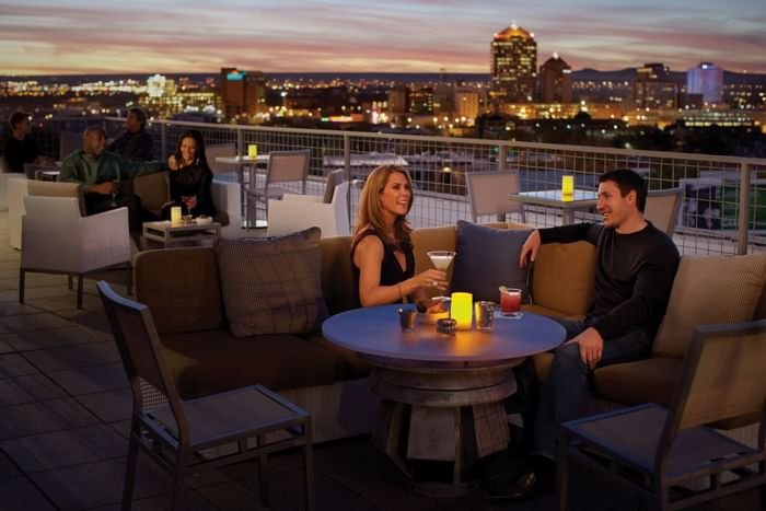 People drinking on rooftop lounge bar