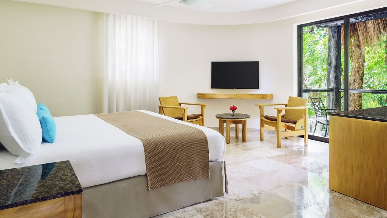 Comfy bed and TV in Premium room at The Reef Playacar