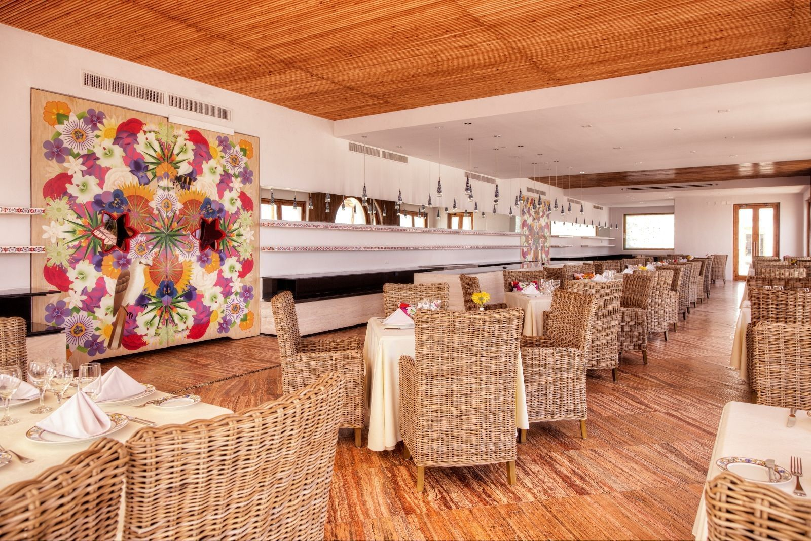 Tables and chairs in a dining area - Marquis Los Cabos