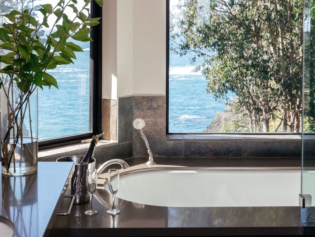 Tub in Ocean View with Tub bathroom at Heritage House Resort