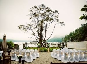 wedding chairs overlooking water on a cloudy day