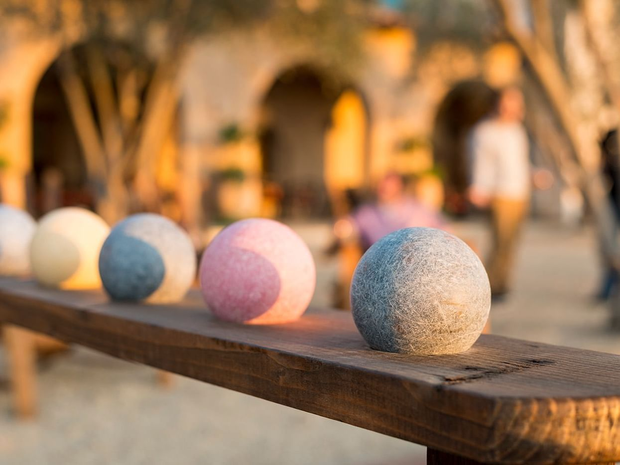 Bocce balls lined up in courtyard area