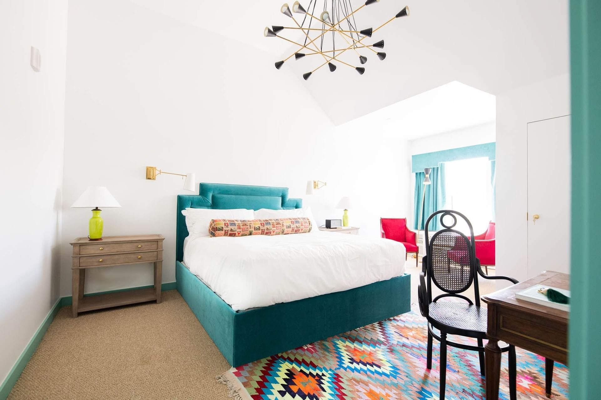 bed with blue bedframe in white room