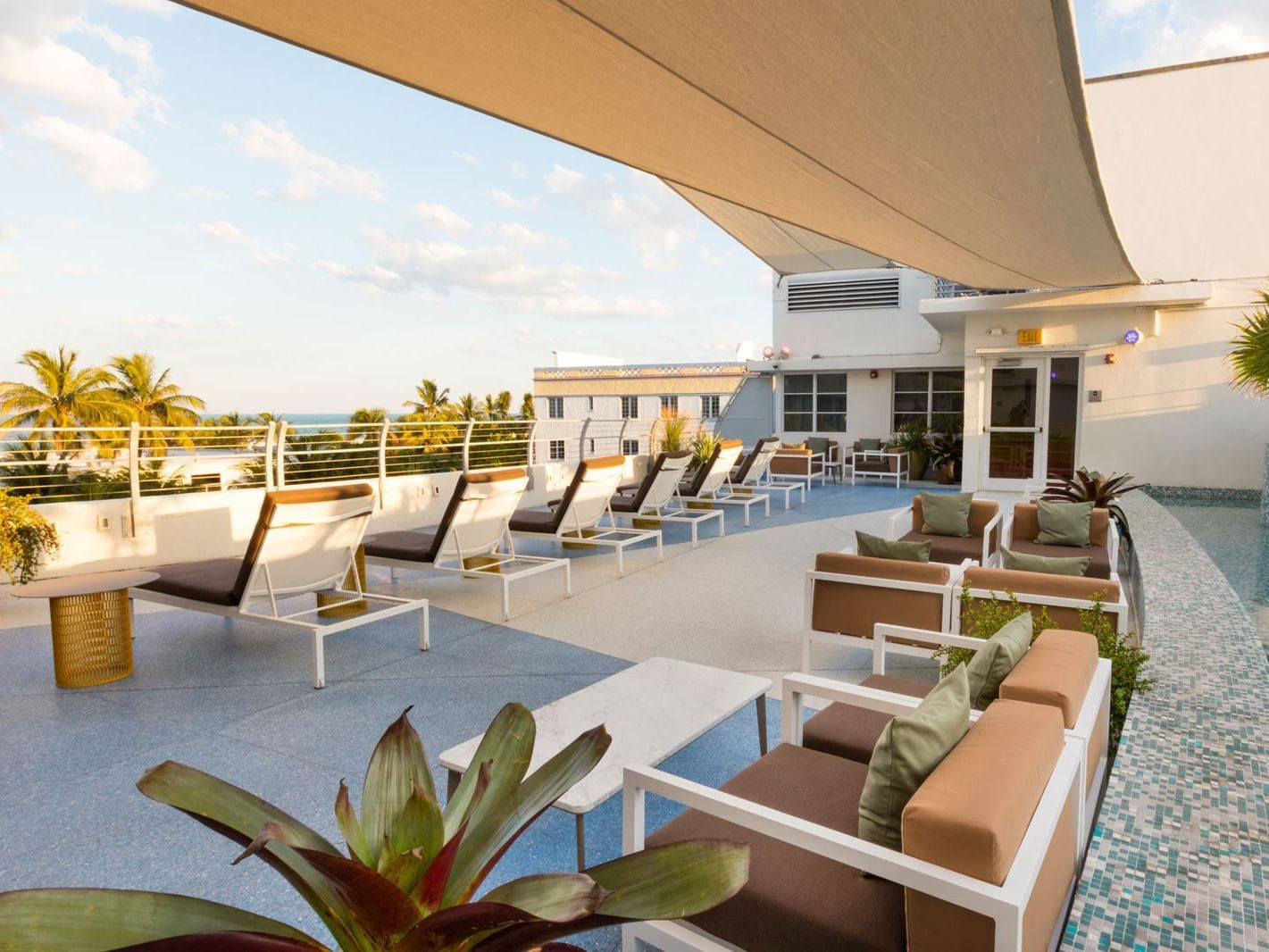 A view of rooftop terrace with sitting area at Essex House by Clevelander