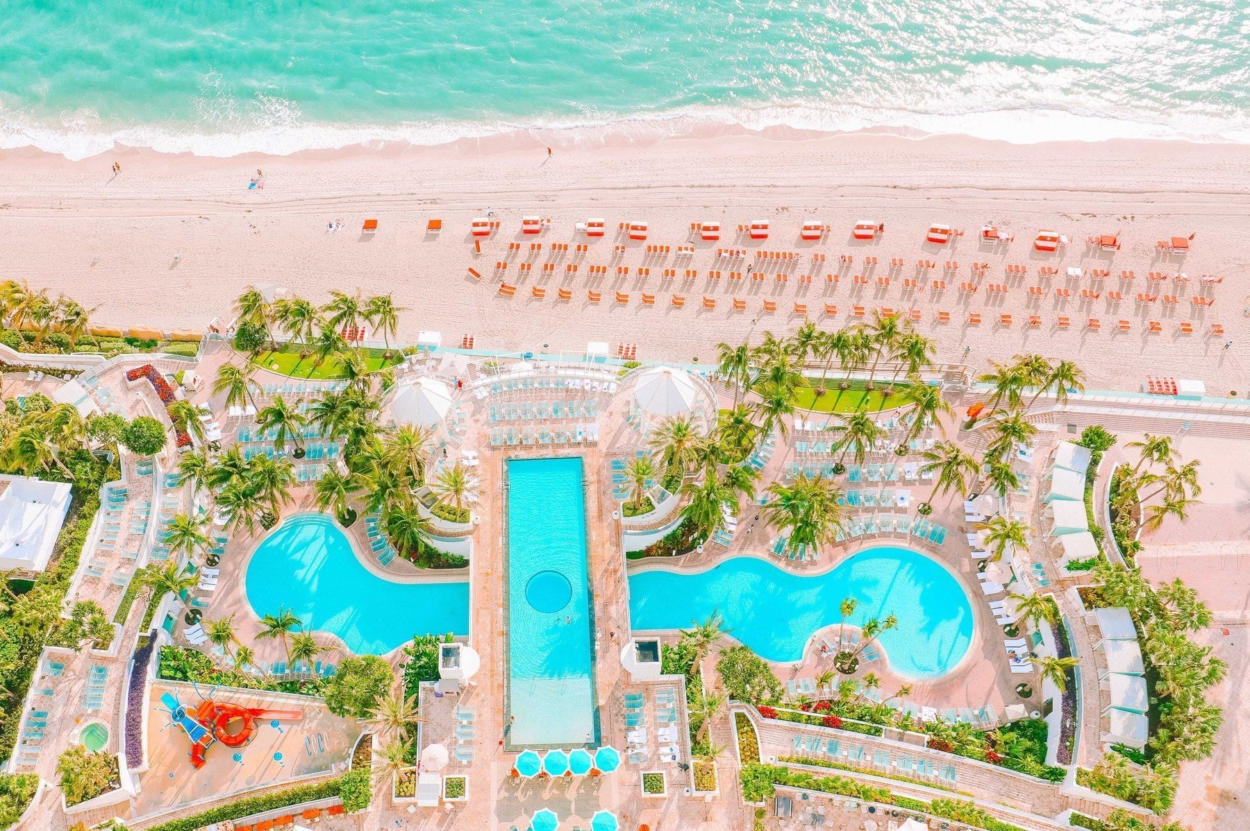 Balcony View Of The Diplomat Resort Pool and Beach