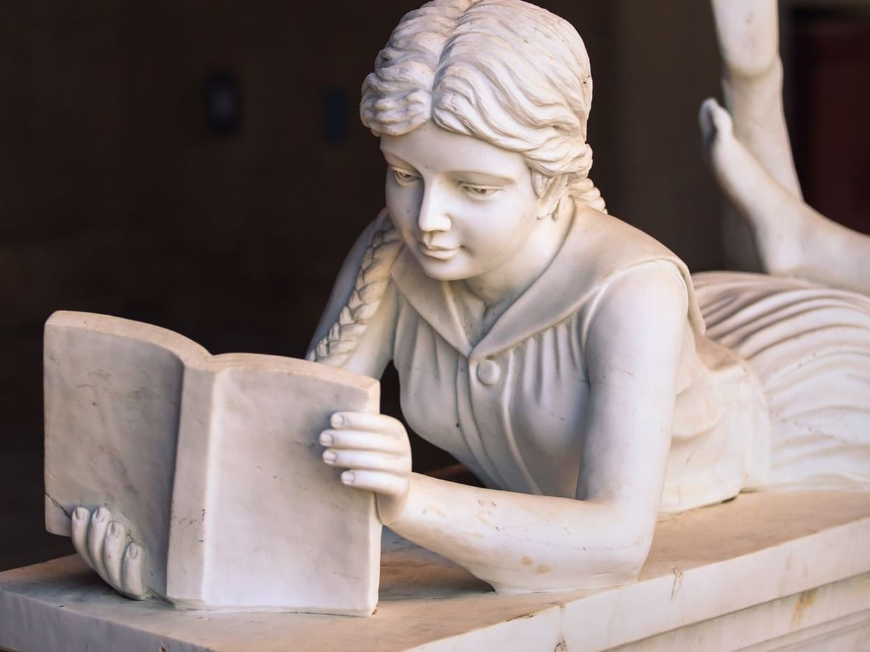 Sculpture of girl reading book