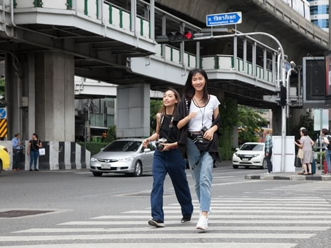 A view of two women crossing a road by the city