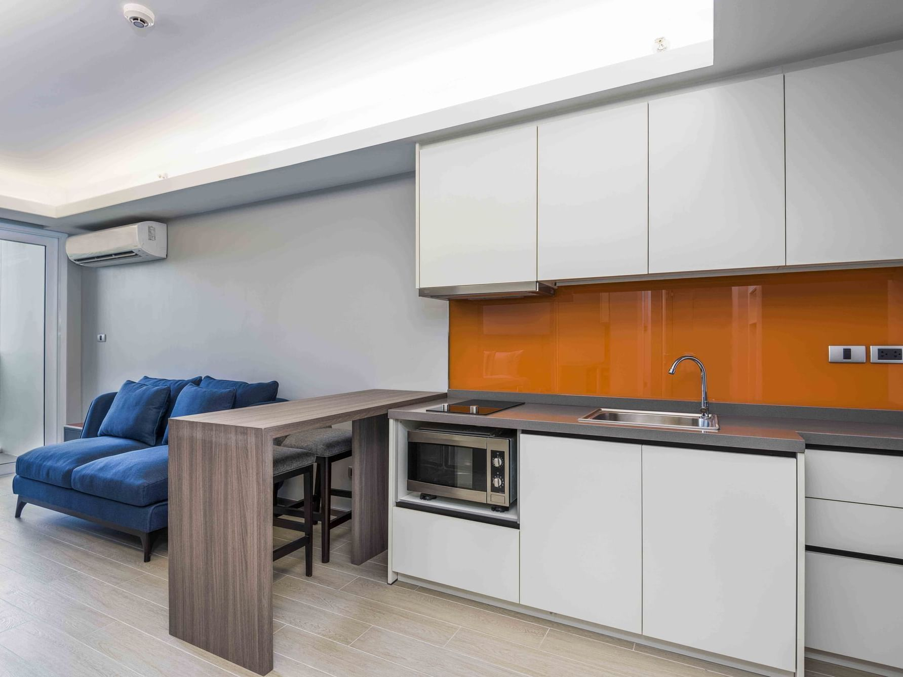 Kitchen at one bedroom apartment at Chatrium hospitality