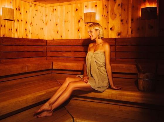 Woman in Sauna at IMLAUER Hotel Schloss Pichlarn