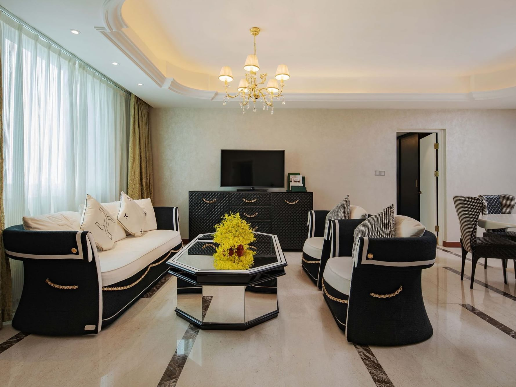 contemporary living room with sofa, television console and coffee table