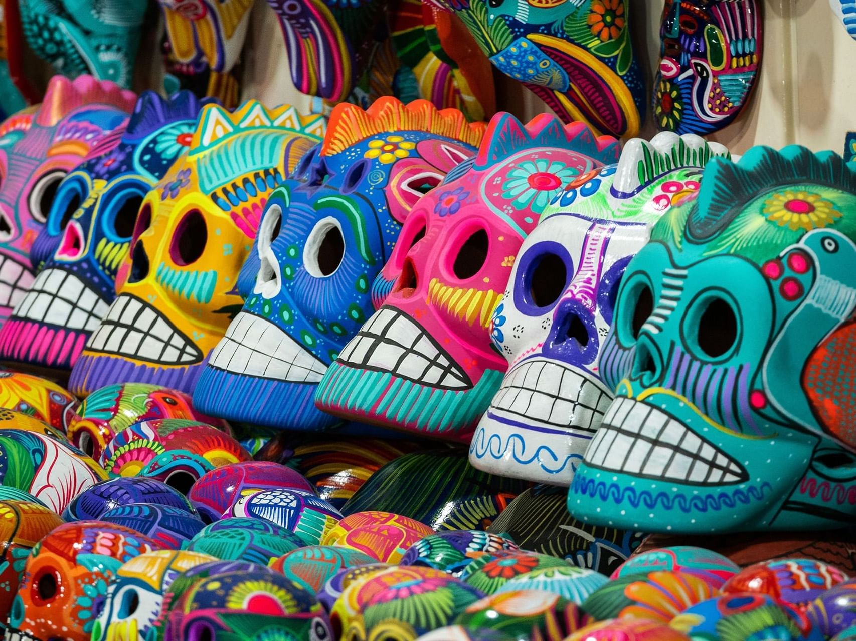 Cultural masks in street market around the La Coleccion Resorts