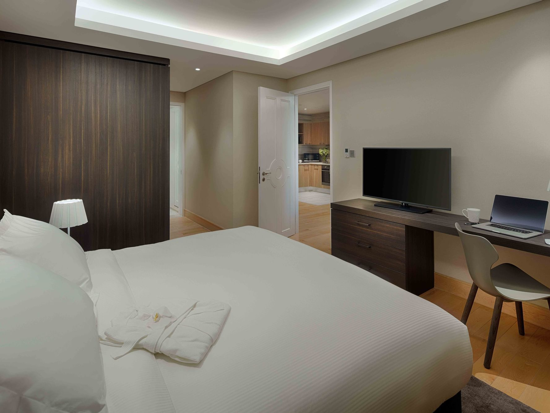hotel room with king bed and study table in front