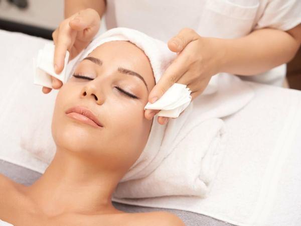 A woman receiving a facial at the Spa in Manteo Resort