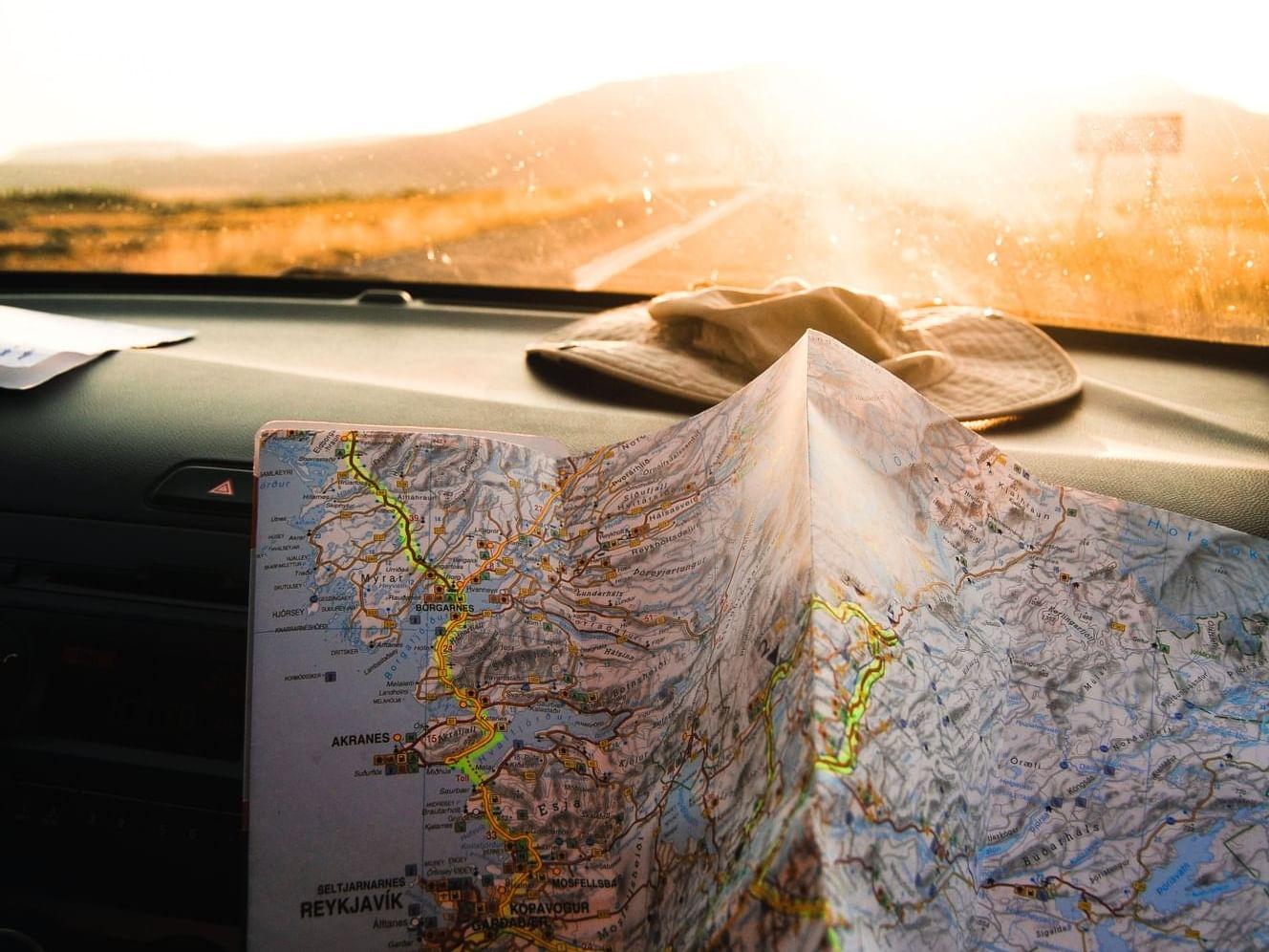 A map on top of a dashboard of a car near Henn Na Hotel