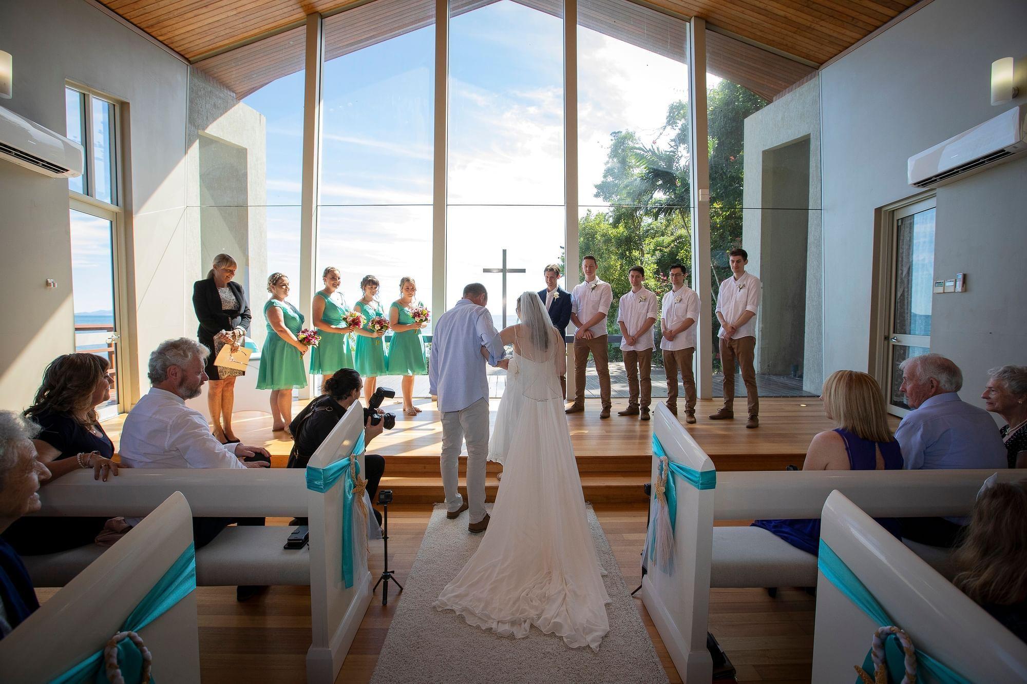 Bride walking down the aisle at Daydream Island Resort