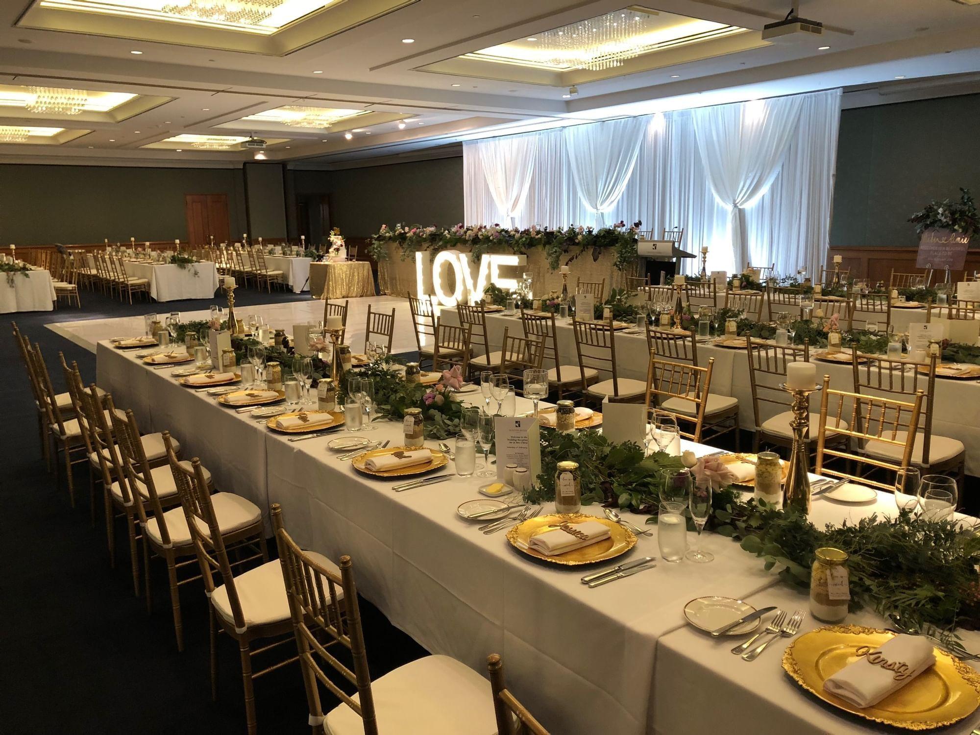 Table setup of the Ballroom wedding reception at Duxton Hotel