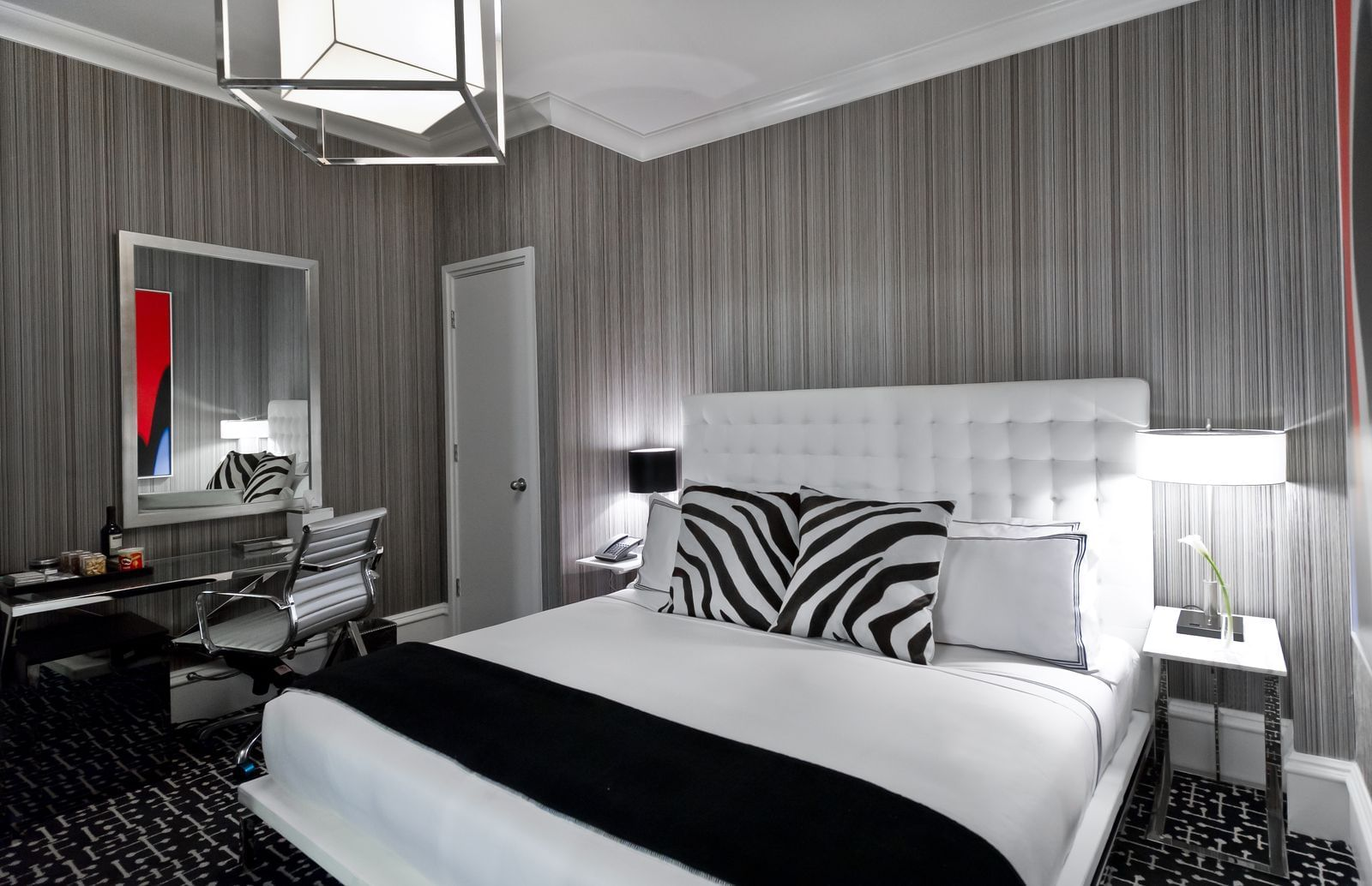 bed in a hotel room with zebra pillows