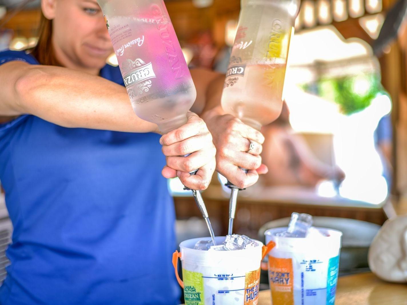 A bartender at Aloha Tiki Bar & Grill in Mystic Dunes Resort