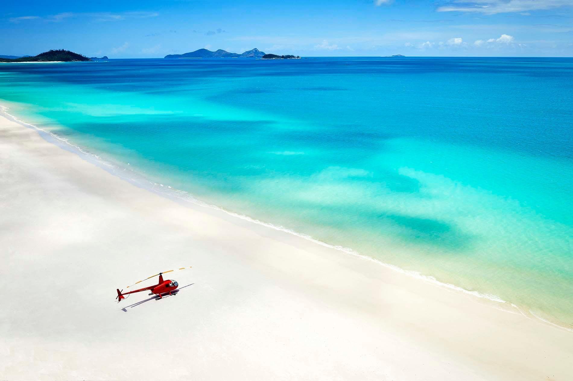 Helicopter on beach near Daydream Island Resort