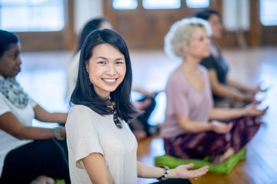Woman smiling during yoga