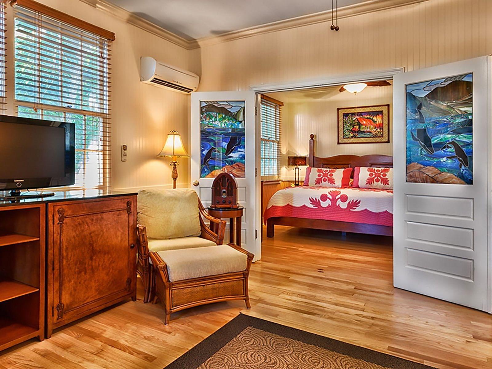 living room with wooden decor and door to bedroom